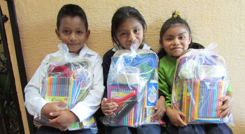 Children with school supplies